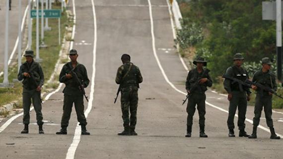 Политика: Общество: Венесуэльские военные заявили, что ждут американцев с оружием в руках